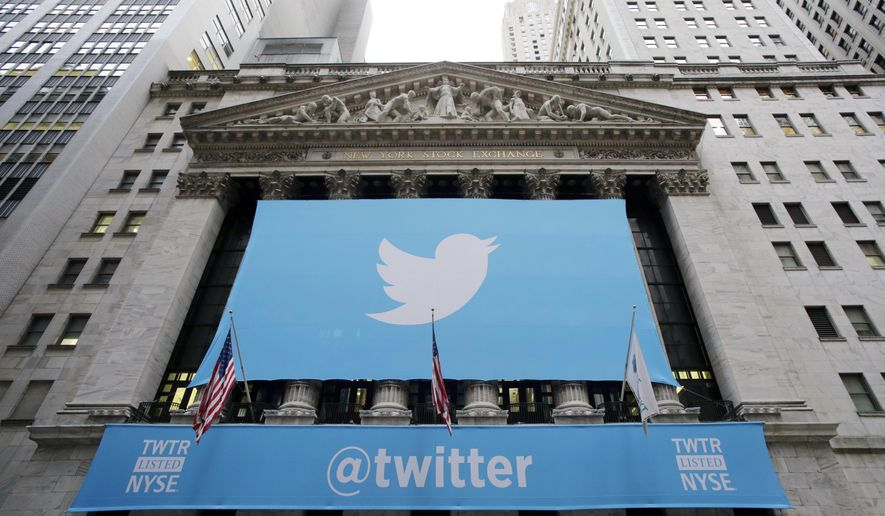 In this Thursday, Nov. 7, 2013, file photo, a banner with the Twitter logo hangs on the facade of the New York Stock Exchange in New York the day after the company went public. (AP Photo/Mark Lennihan, File)
