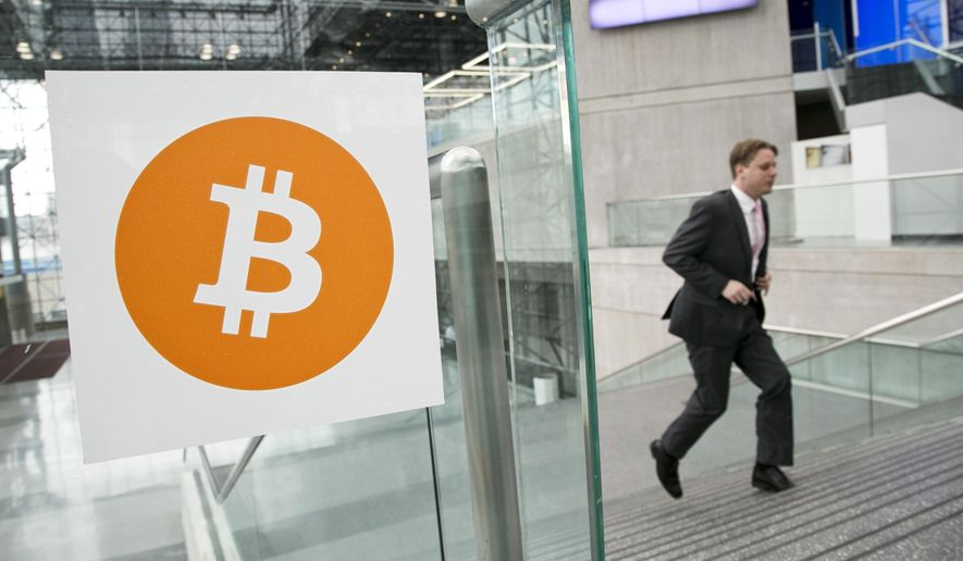 A man arrives for the Inside Bitcoins conference and trade show in New York, April 7, 2014. (Associated Press) ** FILE **