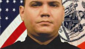 "This undated photo provided by the New York City Police Department shows Officer Dennis Guerra. Guerra died, Wednesday, April 9, 2014 after responding to a mattress fire Sunday at a Brooklyn apartment building. Mayor Bill de Blasio says New York City is ""hurting"" after the death of Guerra, and praised him as an ""exemplary"" officer who was trying to ""save people in need."" (AP Photo/NYPD)"