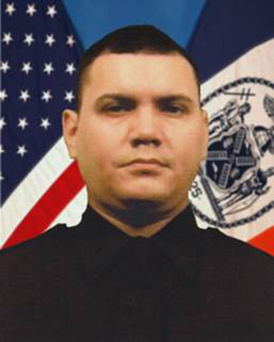 """This undated photo provided by the New York City Police Department shows Officer Dennis Guerra. Guerra died, Wednesday, April 9, 2014 after responding to a mattress fire Sunday at a Brooklyn apartment building. Mayor Bill de Blasio says New York City is """"hurting"""" after the death of Guerra, and praised him as an """"exemplary"""" officer who was trying to """"save people in need."""" (AP Photo/NYPD)"""