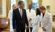 President Barack Obama shares a humorous moment with a group of doctors from around the country in the Oval Office, Oct. 5, 2009, prior to a health insurance reform event at the White House.