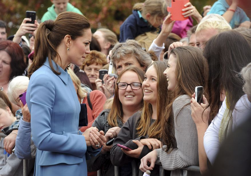 Britain's Kate, the Duchess of Cambridge, left, chats with women in Seymour Square, Blenhiem, New Zealand, Thursday, April 10, 2014. (AP Photo/SNPA, Ross Setford, POOL)