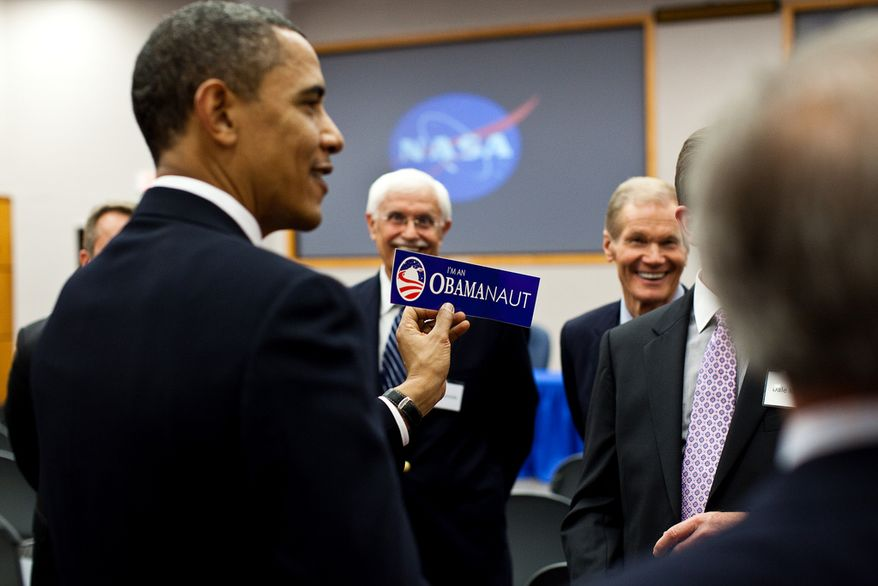 "President Barack Obama is given an ""I'm an Obamanaut"" bumper sticker at NASA operations at the Kennedy Space Center in Cape Canaveral, Fla., April 15, 2010. (Official White House Photo by Pete Souza)"
