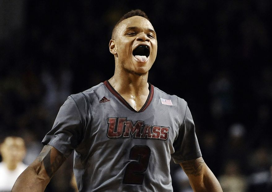 In this Dec. 28, 2013 file photo,UMass guard Derrick Gordon celebrates after hitting the go-ahead basket with one second left on the clock during overtime of an NCAA college basketball game against Providence, in Amherst, Mass. Gordon says in a televised interview that he is gay. Gordon made the announcement on ESPN on Wednesday, April 9, 2014, becoming the first openly gay player in Division I men's basketball.  (AP Photo/Jessica Hill, File)