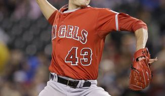 Los Angeles Angels starting pitcher Garrett Richards throws to a Seattle Mariners batter in the sixth inning of a baseball game Wednesday, April 9, 2014, in Seattle. (AP Photo/Elaine Thompson)