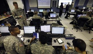 United States Military Academy cadets watch data on computers at the Cyber Research Center at the United States Military Academy in West Point, N.Y., Wednesday, April 9, 2014. The West Point cadets are fending off cyber attacks this week as part of an exercise involving all the service academies. The annual Cyber Defense Exercise requires teams from the five service academies to create computer networks that can withstand attacks from the National Security Agency and the Department of Defense. (AP Photo/Mel Evans)