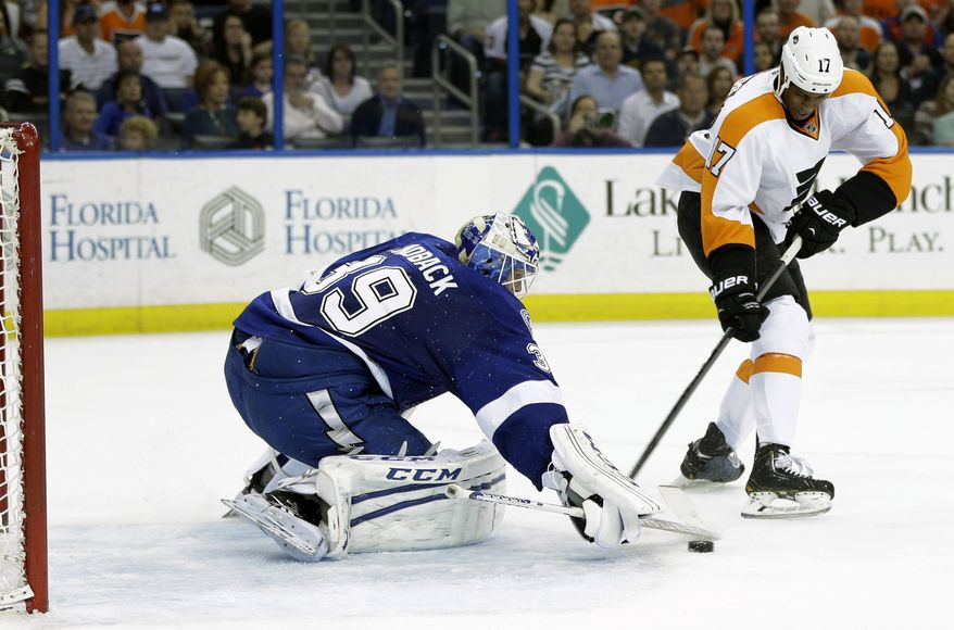 Tampa Bay Lightning goalie Anders Lindback (39), of Sweden, makes a stick save on a shot by Philadelphia Flyers right wing Wayne Simmonds (17) during the first period of an NHL hockey game Thursday, April 10, 2014, in Tampa, Fla. (AP Photo/Chris O'Meara)