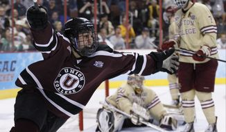 Union's Daniel Ciampini, left, reacts to his goal on Boston College's Thatcher Demko, center, with Isaac MacLeod, right, beside Demko during the second period of an NCAA men's college hockey Frozen Four tournament semfinal, Thursday, April 10, 2014, in Philadelphia. (AP Photo/Chris Szagola)