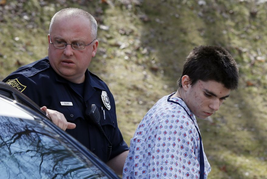 AP10thingsToSee - Alex Hribal, the suspect in the multiple stabbings at the Franklin Regional High School in Murrysville, Pa., is escorted by police to a district magistrate to be arraigned in Export, Pa. on Wednesday, April 9, 2014. Authorities say Hribal has been charged after allegedly stabbing and slashing at least 19 people, including students, in the crowded halls of his suburban Pittsburgh high school Wednesday. (AP Photo/Keith Srakocic)