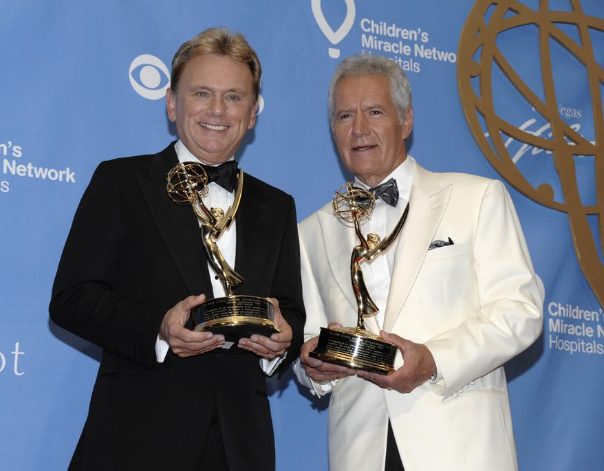 Television personality Pat Sajak, left, and, television personality Alex Trebek pose together with their awards in the press room at the 38th Annual Daytime Emmy Awards in Las Vegas on Sunday, June 19, 2011. Sajak and Trebek both received Lifetime Achievement Awards. (AP Photo/Dan Steinberg)