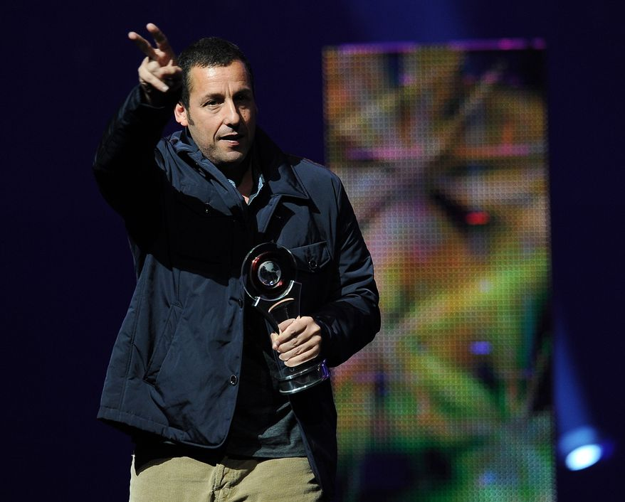 Adam Sandler salutes the crowd after receiving the Male Star of the Year award at the CinemaCon 2014 Big Screen Achievement Awards on Thursday, March 27, 2014 in Las Vegas. (Photo by Chris Pizzello/Invision/AP)