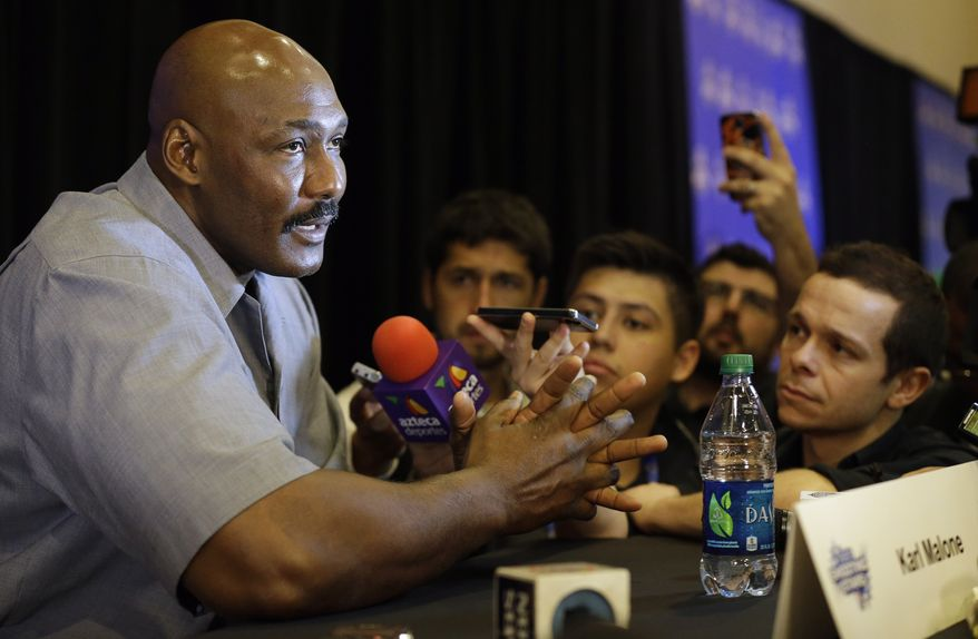 Former NBA basketball player Karl Malone speaks during the NBA All Star basketball news conference, Friday, Feb. 14, 2014, in New Orleans. The 63rd annual NBA All Star game will be played Sunday in New Orleans. (AP Photo/Gerald Herbert) **FILE**