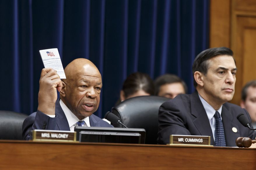 Rep. Elijah Cummings, D-Md., ranking member of the House Oversight Committee, left, holds up a copy of the Constitution as Committee Chairman Rep. Darrell Issa, R-Calif. listens at right as the panel debates whether to find former Internal Revenue Service official Lois Lerner in contempt of Congress for her previous refusal to answer questions at two hearings probing whether tea party and conservative political groups had been targeted for extra scrutiny when they applied for tax-exempt status, Thursday, April 10, 2014, on Capitol Hill in Washington. (AP Photo/J. Scott Applewhite)