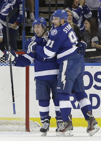 Tampa Bay Lightning center Tyler Johnson, left, celebrates with center Steven Stamkos (91) after scoring against the Philadelphia Flyers during the first period of an NHL hockey game Thursday, April 10, 2014, in Tampa, Fla. (AP Photo/Chris O'Meara)