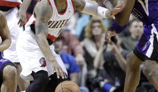 Portland Trail Blazers guard Damian Lillard, left, drives against Sacramento Kings forward Jason Thompson during the first half of an NBA basketball game in Portland, Ore., Wednesday, April 9, 2014. (AP Photo/Don Ryan)