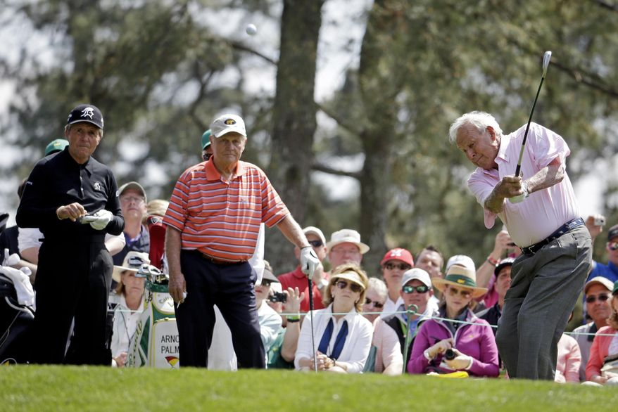From left, Gary Player, Jack Nicklaus watch as Arnold Palmer tees off on the first hole during the par three competition at the Masters golf tournament Wednesday, April 9, 2014, in Augusta, Ga. (AP Photo/Darron Cummings)
