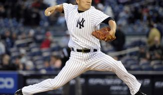 New York Yankees pitcher Masahiro Tanaka delivers the ball during the first inning of the Yankees' baseball game against the Baltimore Orioles on Wednesday, April 9, 2014, at Yankee Stadium in New York. (AP Photo/Bill Kostroun)