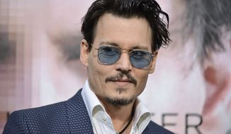 "** FILE ** Johnny Depp arrives at the LA Premiere  Of ""Transcendence"" on Thursday, April 10, 2014, in Los Angeles. (Photo by Richard Shotwell/Invision/AP)"