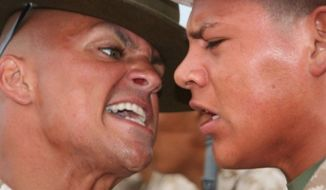 A Marine Corps drill instructor reminds another Marine that pain is weakness leaving the body. (U.S. Marine Corps)
