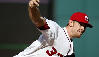 Washington Nationals starting pitcher Stephen Strasburg throws during the third inning of a baseball game against the Miami Marlins at Nationals Park on Thursday, April 10, 2014, in Washington. (AP Photo/Alex Brandon)