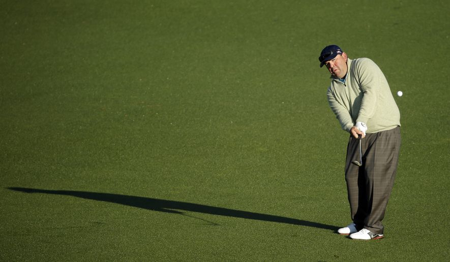 Kevin Stadler hits on the second fairway during the first round of the Masters golf tournament Thursday, April 10, 2014, in Augusta, Ga. (AP Photo/Chris Carlson)