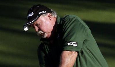Craig Stadler hits to the second green during the first round of the Masters golf tournament Thursday, April 10, 2014, in Augusta, Ga. (AP Photo/Chris Carlson)