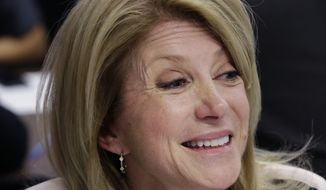 FILE - This March 4, 2014 file photo shows Texas Democratic gubernatorial candidate, State Sen. Wendy Davis visiting with volunteers at her campaign headquarters in Fort Worth, Texas. President Barack Obama has met with Wendy Davis, the Democratic nominee for governor. The White House says Obama visited briefly with Davis on Thursday at the LBJ Presidential Library in the state capital of Austin. That's where Obama delivered a speech commemorating the 50th anniversary of the Civil Rights Act. (AP Photo/LM Otero, File)