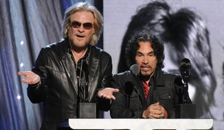 Hall of Fame Inductees, Hall and Oates, Daryl Hall and John Oates speak at the 2014 Rock and Roll Hall of Fame Induction Ceremony on Thursday, April, 10, 2014 in New York. (Photo by Charles Sykes/Invision/AP)