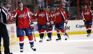 Washington Capitals center Jay Beagle (83) celebrates his goal in the second period of an NHL hockey game against the Chicago Blackhawks, Friday, April 11, 2014, in Washington. (AP Photo/Alex Brandon)