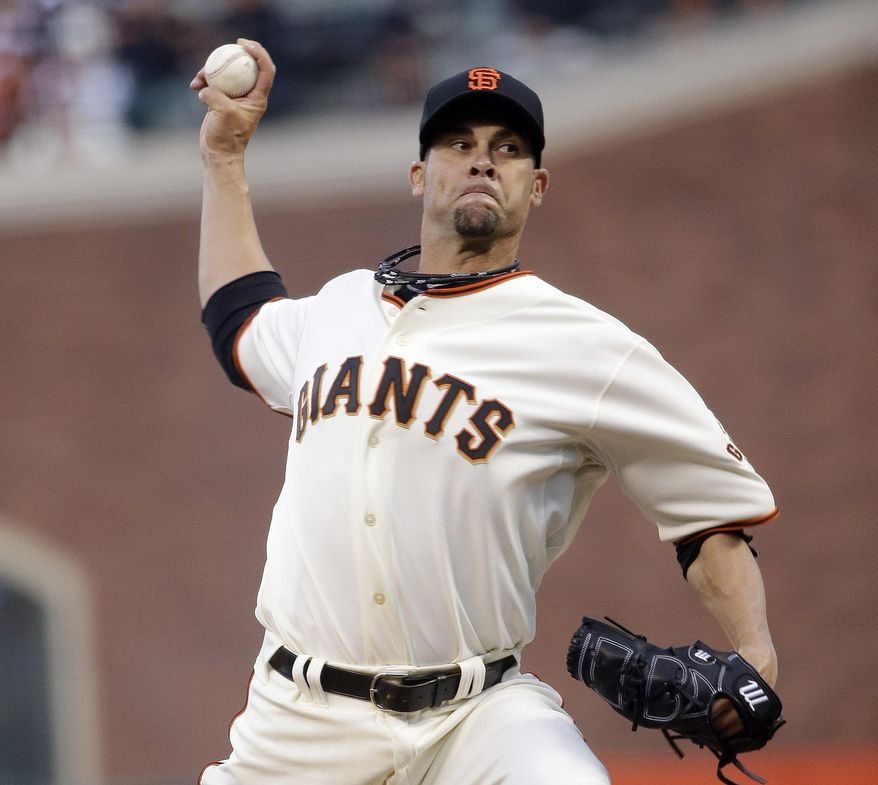 San Francisco Giants starting pitcher Ryan Vogelsong throws to the Arizona Diamondbacks during the first inning of a baseball game on Thursday, April 10, 2014, in San Francisco. (AP Photo/Marcio Jose Sanchez)