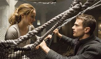 """This image released by Summit Entertainment shows Shailene Woodley, left, and Theo James in a scene from """"Divergent."""" Lions Gate Entertainment Corp. says the final book of its """"Divergent"""" trilogy will be made into two parts, following the lucrative formula it has used for """"Twilight"""" and is repeating for """"The Hunger Games."""" (AP Photo/Summit Entertainment, Jaap Buitendijk, file)"""