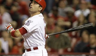 Cincinnati Reds' Joey Votto hits a solo home run off Tampa Bay Rays starting pitcher David Price in the ninth inning of a baseball game, Friday, April 11, 2014, in Cincinnati. Tampa Bay won 2-1. (AP Photo/Al Behrman)