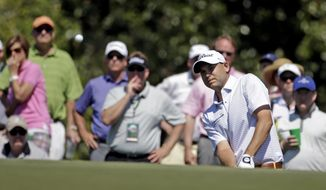 Bill Haas watches his chip shot to the 17th green during the first round of the Masters golf tournament Thursday, April 10, 2014, in Augusta, Ga. (AP Photo/Darron Cummings)