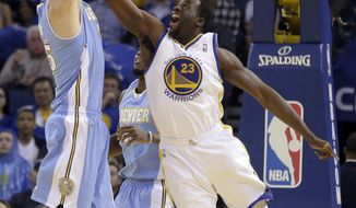 Golden State Warriors' Draymond Green, right, attempts to block the shot of Denver Nuggets' Timofey Mozgov during the first half of an NBA basketball game Thursday, April 10, 2014, in Oakland, Calif. (AP Photo/Ben Margot)