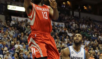 Houston Rockets guard James Harden (13) goes up for a shot in front of Minnesota Timberwolves forward Luc Richard Mbah a Moute (12) during the second quarter of an NBA basketball game in Minneapolis, Friday, April 11, 2014. (AP Photo/Ann Heisenfelt)