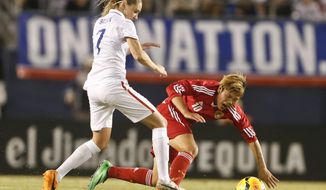 U.S. midfielder Morgan Brian sends China forward Li Ying to the ground during the first half of an international friendly soccer match, Thursday, April 10, 2014, in San Diego. (AP Photo/Lenny Ignelzi)