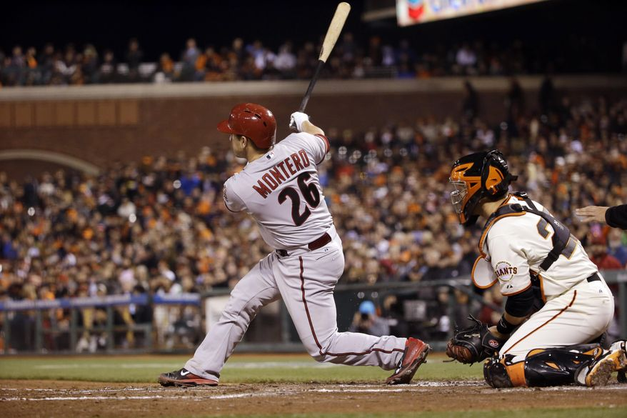 Arizona Diamondbacks' Miguel Montero (26) drives in two runs with a double against the San Francisco Giants during the third inning of a baseball game on Thursday, April 10, 2014, in San Francisco. (AP Photo/Marcio Jose Sanchez)