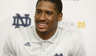 FILe - In this March 3, 2014 file photo, Notre Dame quarterback Everett Golson speaks to the media after the opening day of spring football practice in South Bend, Ind. Golson admits to being a bit jittery at the first day of spring practice last month after being suspended from school last fall for academic impropriety.  (AP Photo/South Bend Tribune, James Brosher, File)