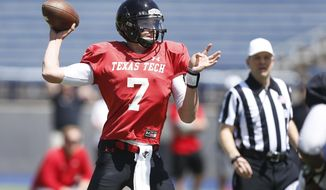 In this March 29, 2014 photo, Texas Tech's Davis Webb looks for a receiver down field during football practice in Midland, Texas.  Last season Webb battled to become Texas Tech's starting quarterback. His year ended with a stellar performance and the MVP in the Red Raiders Holiday Bowl win. (AP Photo/Lubbock Avalanche-Journal, Stephen Spillman)