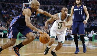 Charlotte Bobcats' Gerald Henderson (9) drives past Boston Celtics' Avery Bradley (0) as the Bobcats' Josh McRoberts (11) looks on in the second quarter of an NBA basketball game in Boston, Friday, April 11, 2014. (AP Photo/Michael Dwyer)
