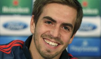 Bayern's Philipp Lahm smiles as he listens to questions during a press conference in Munich, southern Germany, Tuesday, April 8, 2014. Bayern Munich will play Manchester United in a Champions League quarter final second leg soccer match on Wednesday. (AP Photo/Matthias Schrader)