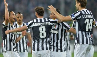 Juventus midfielder Claudio Marchisio celebrates after scoring during the Europa League quarterfinal soccer match between Juventus and Olympic Lyon at the Juventus stadium, in Turin, Italy, Thursday, April 10, 2014. (AP Photo/ Massimo Pinca)