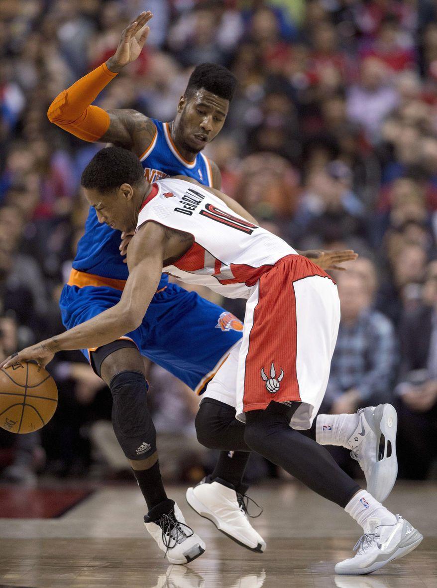 Toronto Raptors guard DeMar DeRozan (10) collides with New York Knicks guard Iman Shumpert during the first half of an NBA basketball game Friday, April 11, 2014, in Toronto. (AP Photo/The Canadian Press, Frank Gunn)