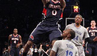 Atlanta Hawks' Jeff Teague (0) shoots against Brooklyn Nets' Marquis Teague (12) during the first half of an NBA basketball game Friday, April 11, 2014, in New York. (AP Photo/Jason DeCrow)