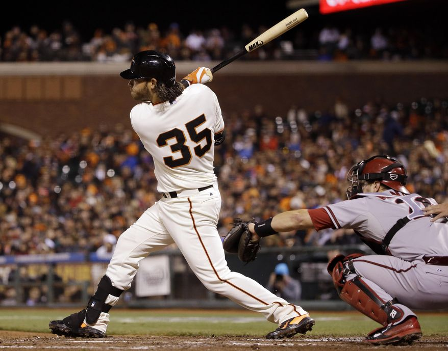 San Francisco Giants' Brandon Crawford drives in a run with a double against the Arizona Diamondbacks during the fourth inning of a baseball game on Thursday, April 10, 2014, in San Francisco. (AP Photo/Marcio Jose Sanchez)