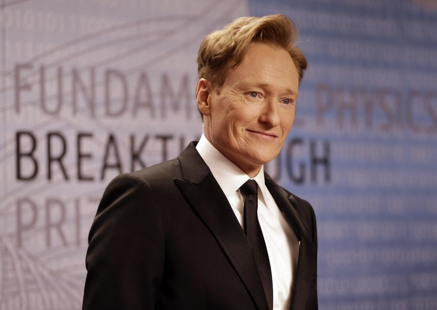 FILE - In this Dec. 12, 2013, file photo, talk show host Conan O'Brien arrives for the Breakthrough Prize in Life Sciences awards in Moffett Field, Calif. O'Brien hosts the 2014 MTV Movie Awards on Sunday, April 13, 2014, at the Nokia Theatre in downtown Los Angeles. (AP Photo/Ben Margot, file)