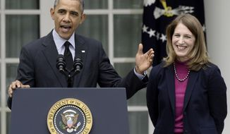 President Barack Obama, stands with his nominee to become Health and Human Services secretary, Budget Director Sylvia Mathews Burwell, while speaking in the Rose Garden of the White House in Washington, Friday, April 11, 2014, where he made the announcement. Burwell would replace Kathleen Sebelius who announced her resignation Thursday. (AP Photo/Susan Walsh)