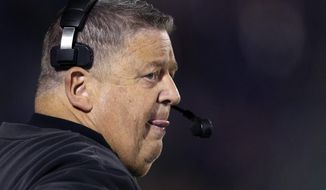 FILE  - In this Oct. 26, 2013 file photo, Kansas head coach Charlie Weis watches his team play in the third quarter of an NCAA college football game against Baylor , in Lawrence, Kan. Weis has plenty to keep an eye on when the Jayhawks play their annual spring game Saturday, nothing more critical than the play of his quarterbacks.  (AP Photo/Ed Zurga, File)