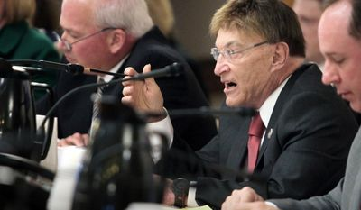 FILE - In this April 23, 2013, file photo Wisconsin Sen. Mike Ellis, R-Neenah, directs a question during a hearing in Madison, Wis. The Republican Senate President will not seek re-election this fall, following the release of a secretly recorded video in which he discusses an illegal campaign finance scheme. Ellis's spokesman Scott Kelly confirmed Friday, April 11, 2014, that Ellis was dropping out, marking the end of a 44-year legislative career. (AP Photo/Wisconsin State Journal, John Hart, File)