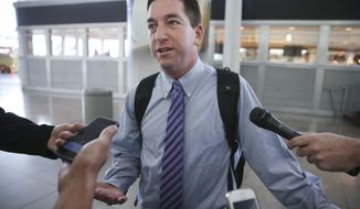 Glenn Greenwald speaks to the media after arriving at John F. Kennedy International Airport, on Friday, April 11, 2014 in New York.  Greenwald and Laura Poitras of the Guardian share a George Polk Award for national security reporting with The Guardian's Ewen MacAskill and Barton Gellman, who has led The Washington Post's reporting on the NSA documents. Greenwald returned to the United States for the first time since the story broke to receive the journalism award.  (AP Photo/John Minchillo)
